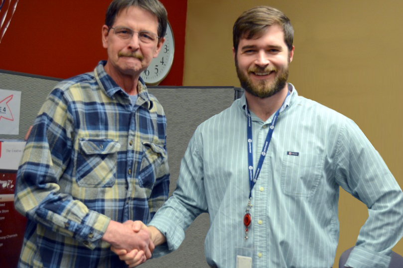 CallCenter.com CEO & Founder, Kyle Hannah, congratulates Customer Service Special Agent, Bob Gelschus, on a near-perfect attendance record. Bob won a flat-screen television for his unparalleled reliability.